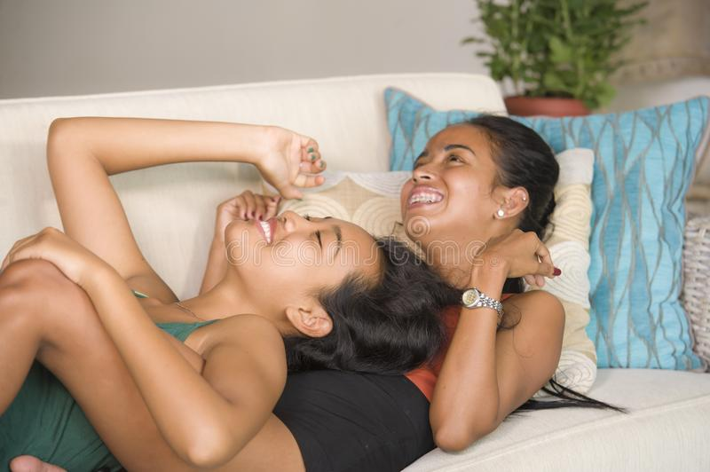 Happy beautiful Asian gay girlfriends couple laughing cheerful together having fun at home sofa couch cuddling and enjoying in wom. En friendship or homosexual royalty free stock photos