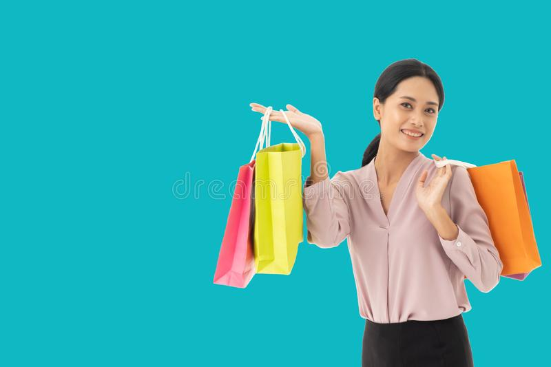Happy beautiful Asian women smile two hand holding shopping bags stock photos