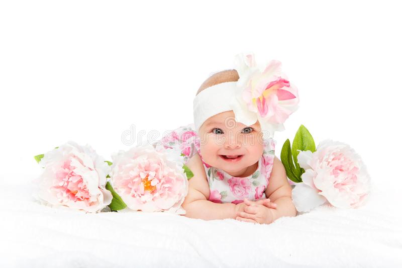 Happy beautiful baby girl with flower on head stock photo