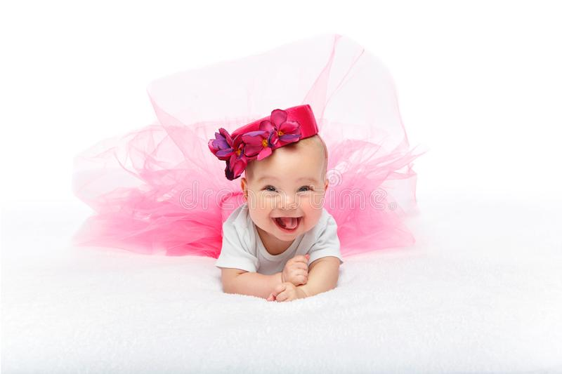 Happy beautiful baby girl with pink hat on head stock photos