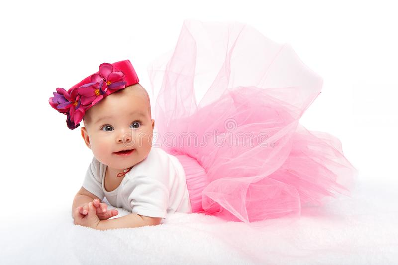 Happy beautiful baby girl with pink hat on head royalty free stock photos