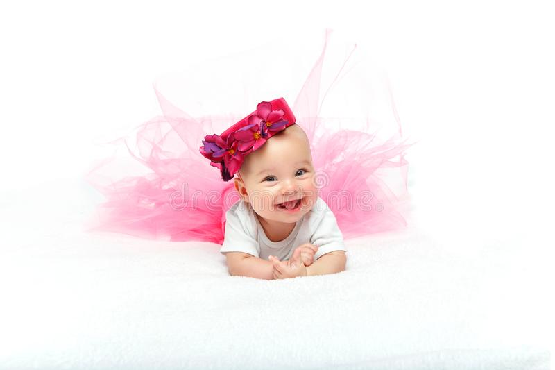Happy beautiful baby girl with pink hat on head stock images