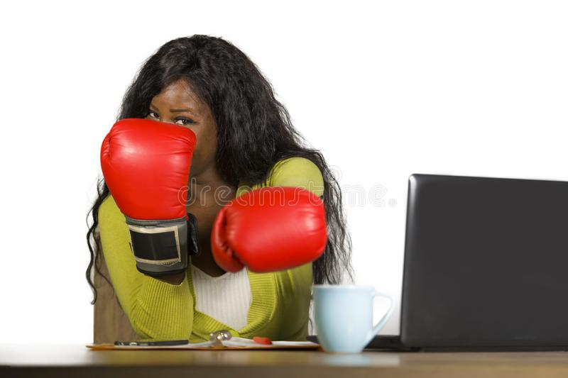 Happy beautiful black afro American woman in boxing gloves smiling cheerful working at office computer desk posing as successful e royalty free stock photography
