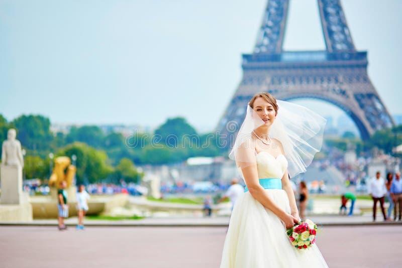 Happy beautiful bride holding wedding bouquet stock image