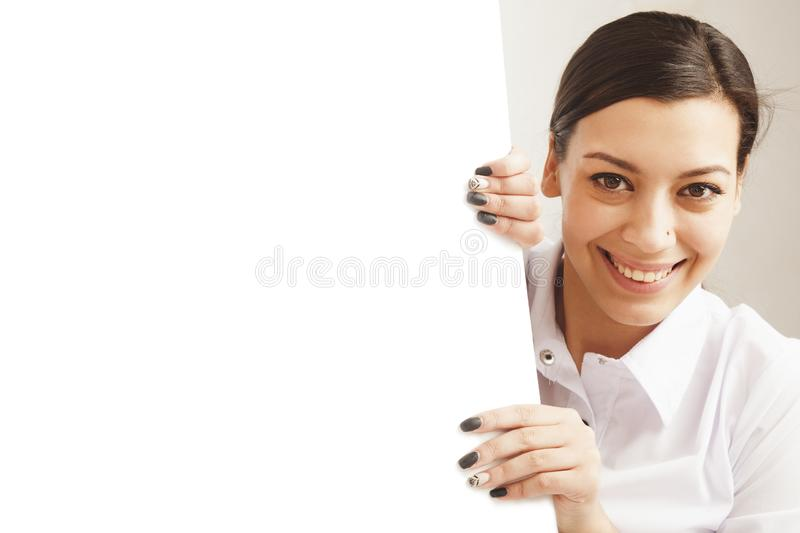 Happy beautiful business woman holding blank white poster billboard royalty free stock photo