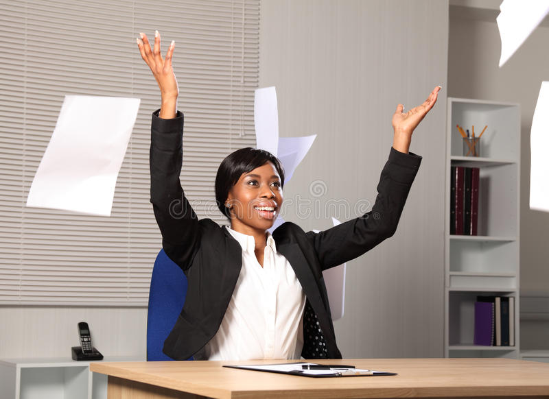 Happy beautiful business woman throws paper in air stock photos