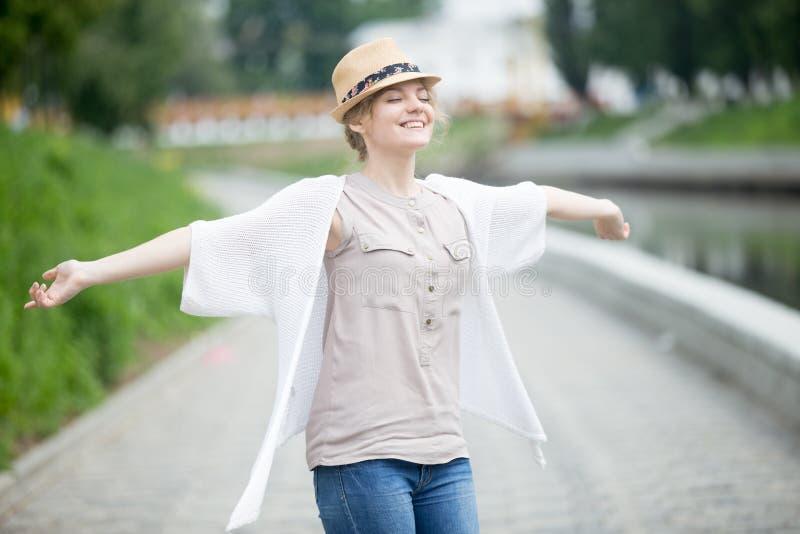 Happy beautiful caucasian woman in summer feeling joyful outdoor stock images