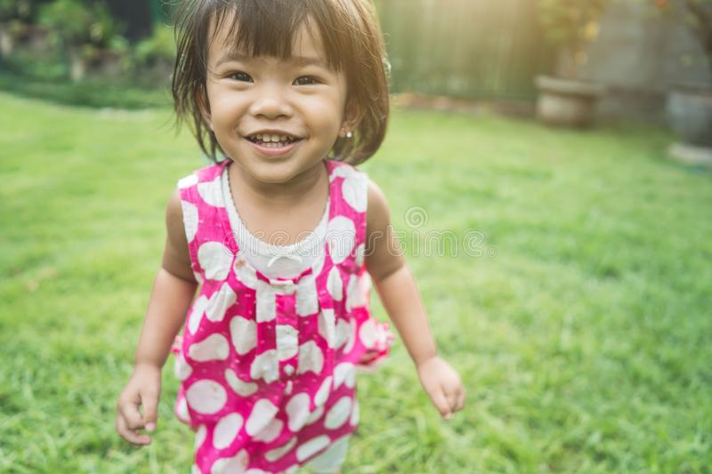 Happy beautiful child`s expression at home backyard royalty free stock photos