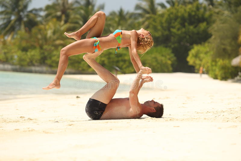 Happy Beautiful Couple having fun Enjoying At Beach in Maldives sunny day hot sand stock image