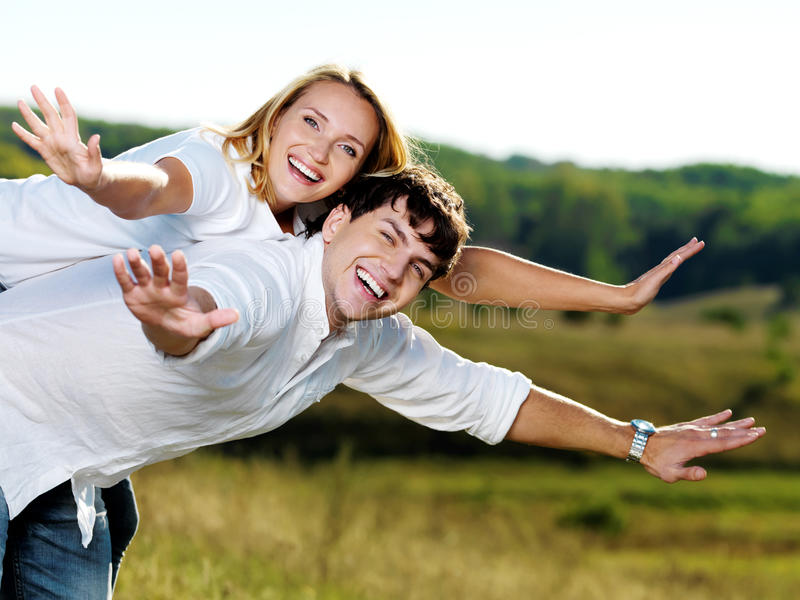 Happy beautiful couple on nature