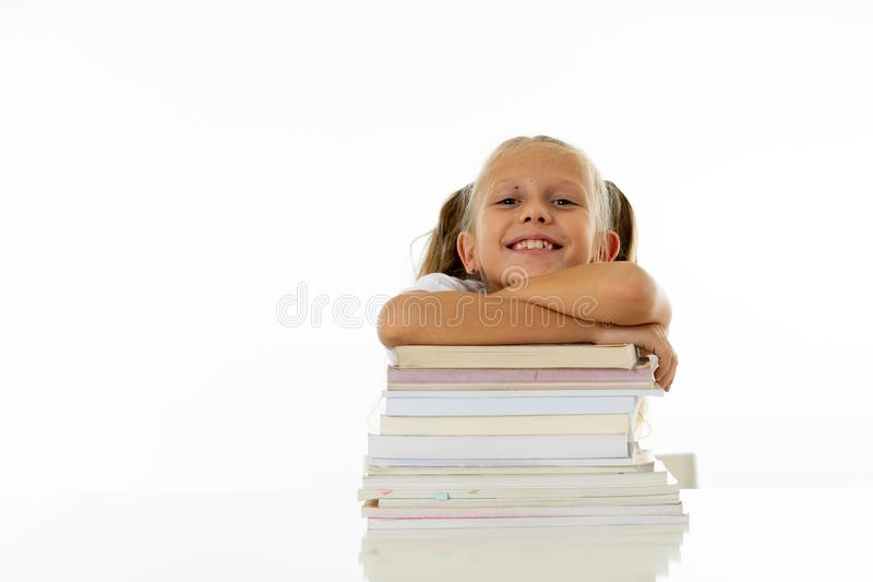 Happy beautiful cute with blond hair little schoolgirl likes studying and reading books in creative education concept with Back to stock photo