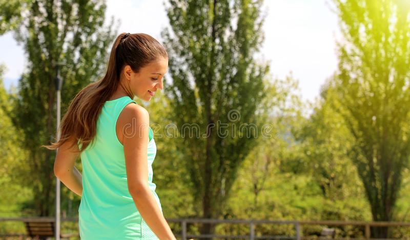 Happy beautiful dynamics sporty woman looking to the side. Fitness girl enjoying her work out in the park. Copy space royalty free stock photos