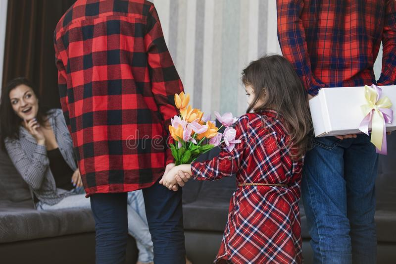 Happy beautiful family give a gift and flowers for my mother for stock images