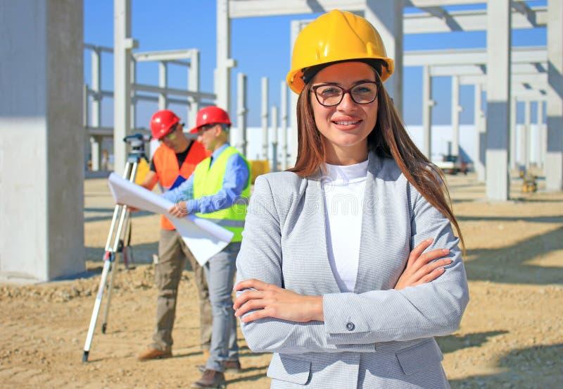Happy beautiful female architect on construction site royalty free stock image