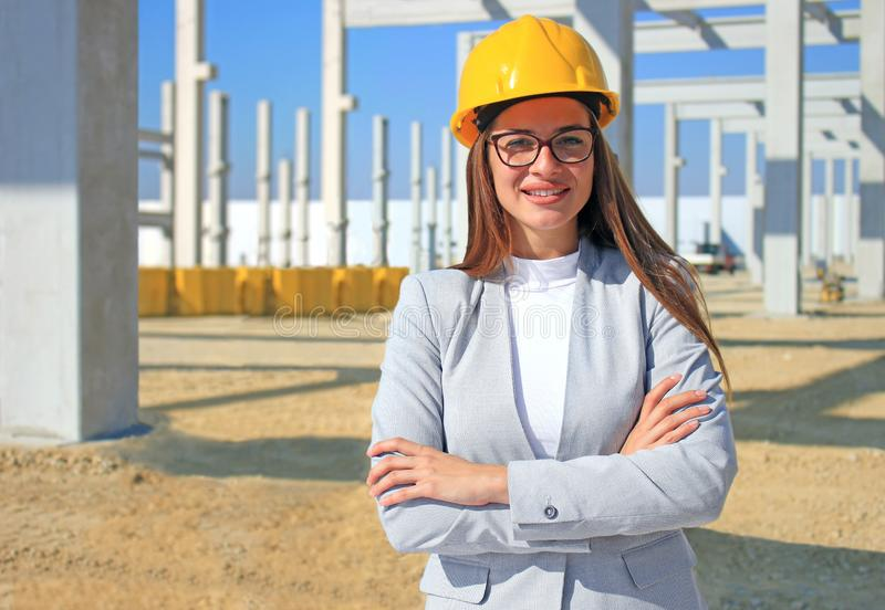 Happy beautiful female architect on construction site stock photos