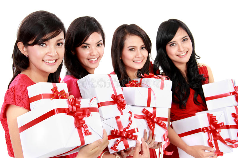 Happy beautiful four asian woman with christmas santa hat holding gift boxes stock photos