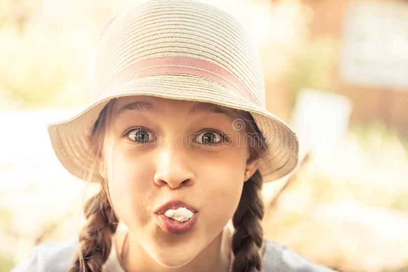 Happy beautiful funny smiling child girl portrait fooling outdoors stock photo