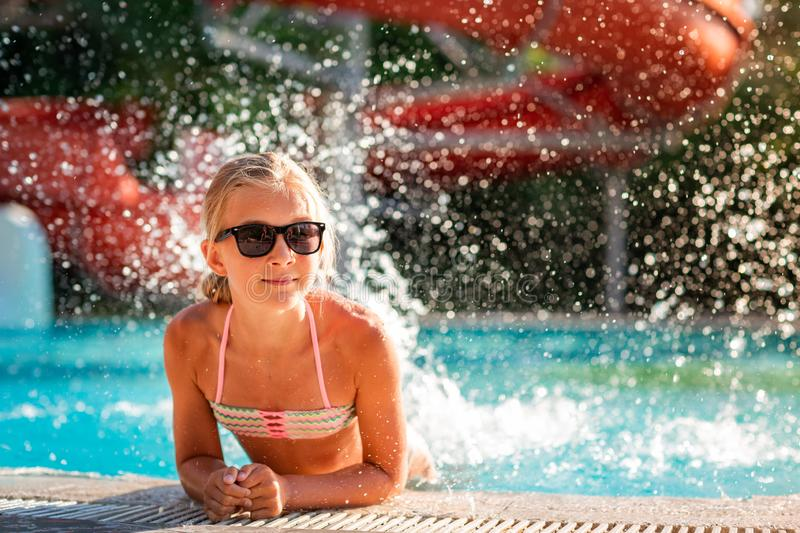 Happy beautiful girl having fun at the pool. At the resort royalty free stock images