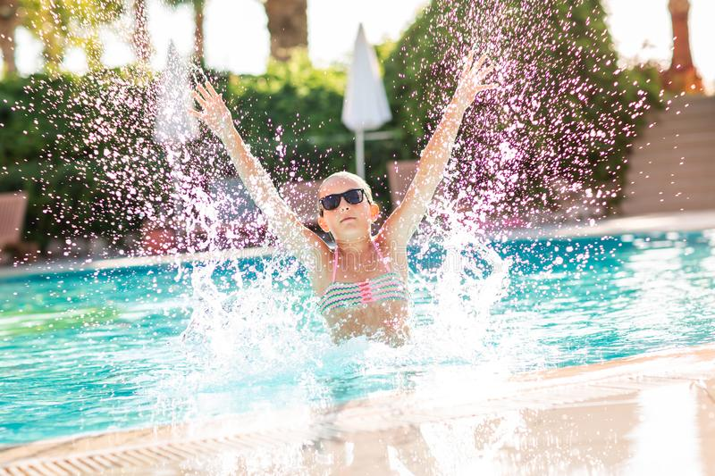 Happy beautiful girl having fun at the pool royalty free stock photos