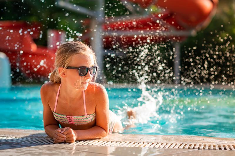 Happy beautiful girl having fun at the pool royalty free stock photography