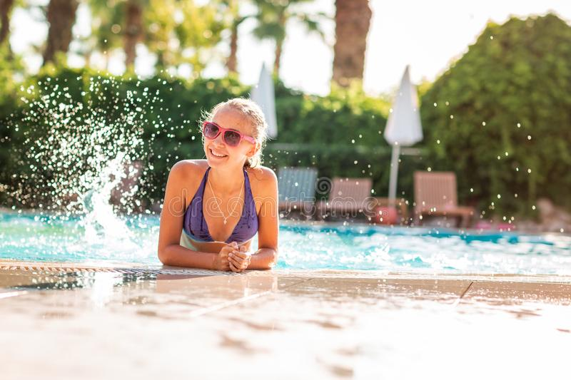 Happy beautiful girl having fun at the pool. At the resort stock photography