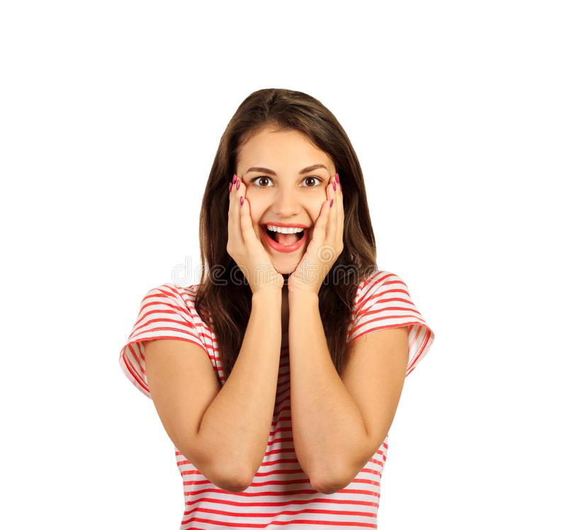 Happy beautiful girl holding her cheeks with a laugh looking to the side. Expressive facial expressions. emotional girl isolated o. N white background royalty free stock photo