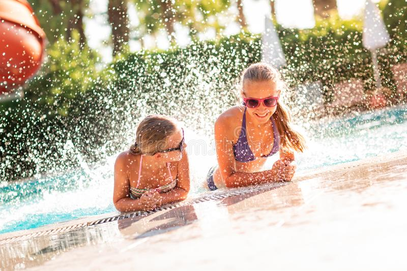 Happy beautiful girls having fun at the pool. At the resort royalty free stock photography