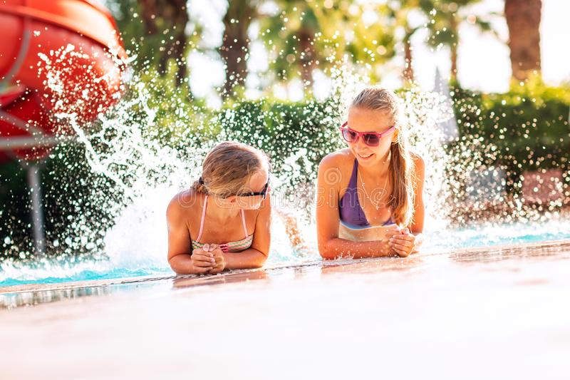 Happy beautiful girls having fun at the pool. At the resort stock images