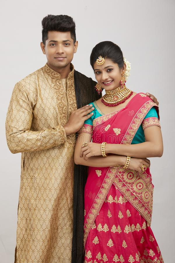Happy beautiful Indian couple portrait in traditional dress stock photos