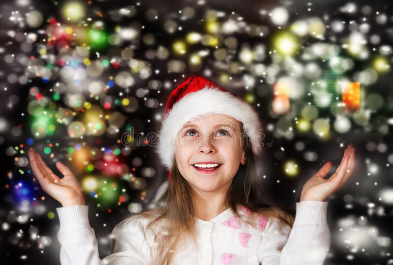 Happy beautiful little girl looks at the sky in the Christmas stock photo