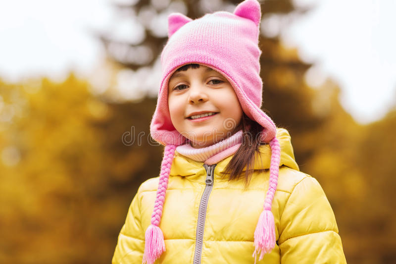 Happy beautiful little girl portrait outdoors. Autumn, childhood, happiness and people concept - happy beautiful little girl portrait outdoors royalty free stock photos