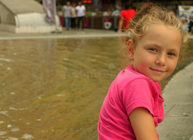 Happy beautiful little girl portrait outdoors stock image