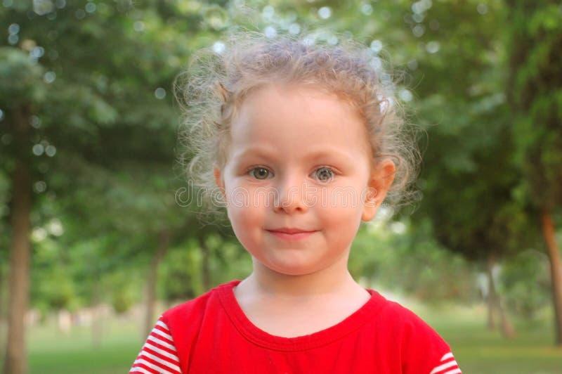 Happy beautiful little girl portrait outdoors stock photo