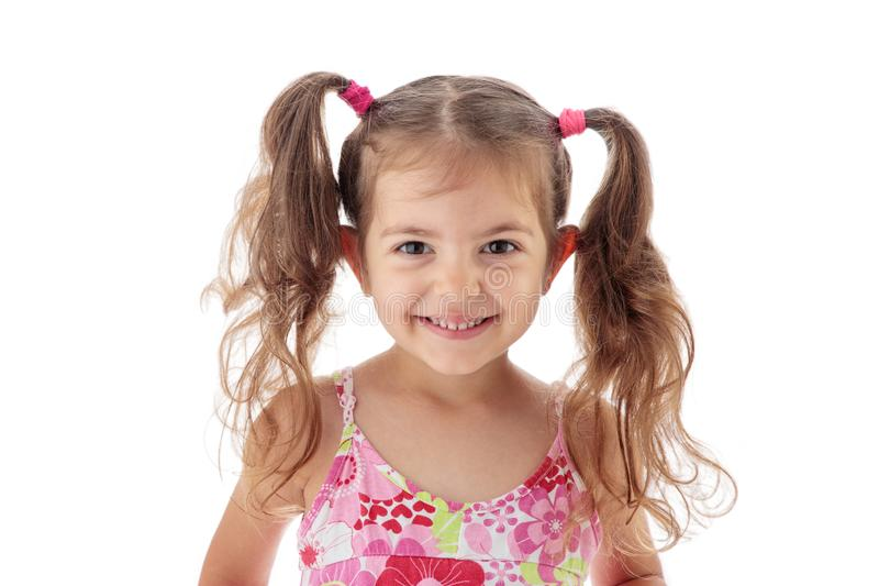 Happy beautiful little girl smiling against camera, portrait royalty free stock photos