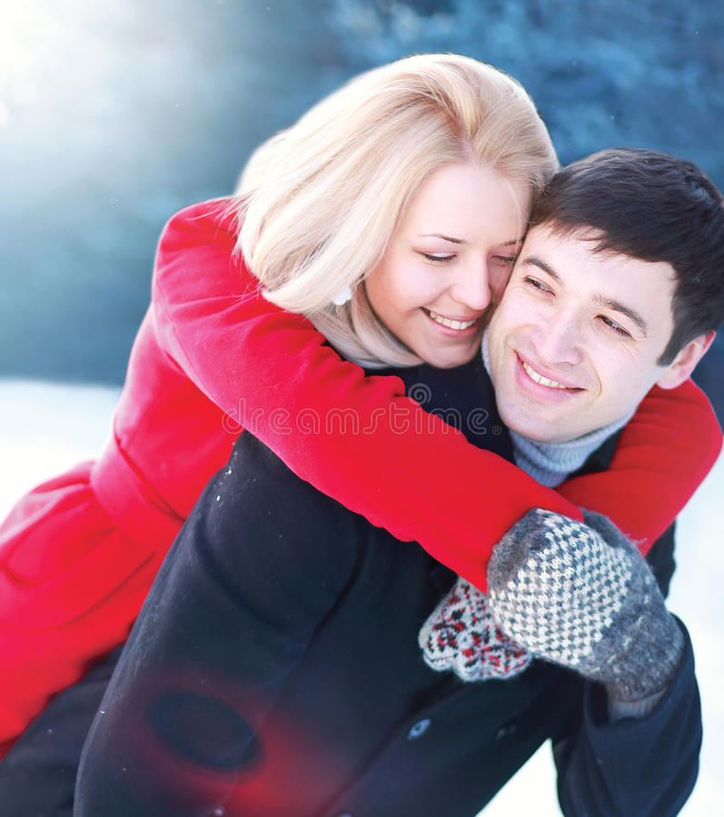 Happy beautiful loving couple having fun in winter stock photos