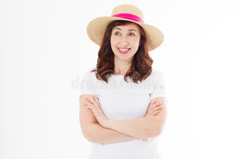 Happy beautiful middle age woman in summer hat isolated on white background. Summertime head and face skin care protection. Hot royalty free stock photo