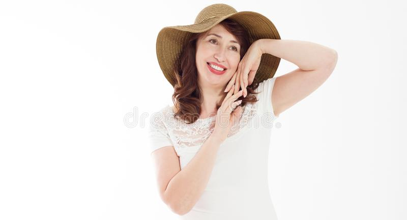 Happy beautiful middle age woman in summer hat isolated on white background. Summertime head and face skin care protection. Hot royalty free stock photos