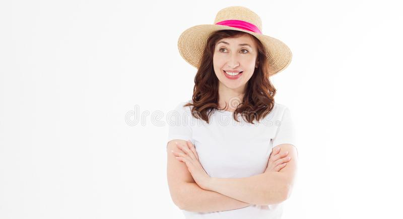 Happy beautiful middle age woman in summer hat isolated on white background. Summertime head and face skin care protection. Hot royalty free stock photography