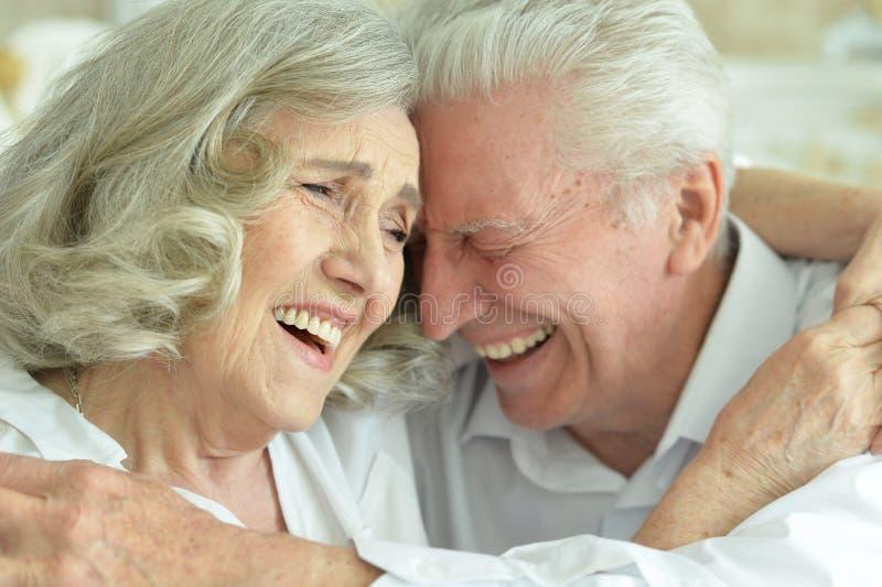 Close up portrait of happy senior couple posing stock images