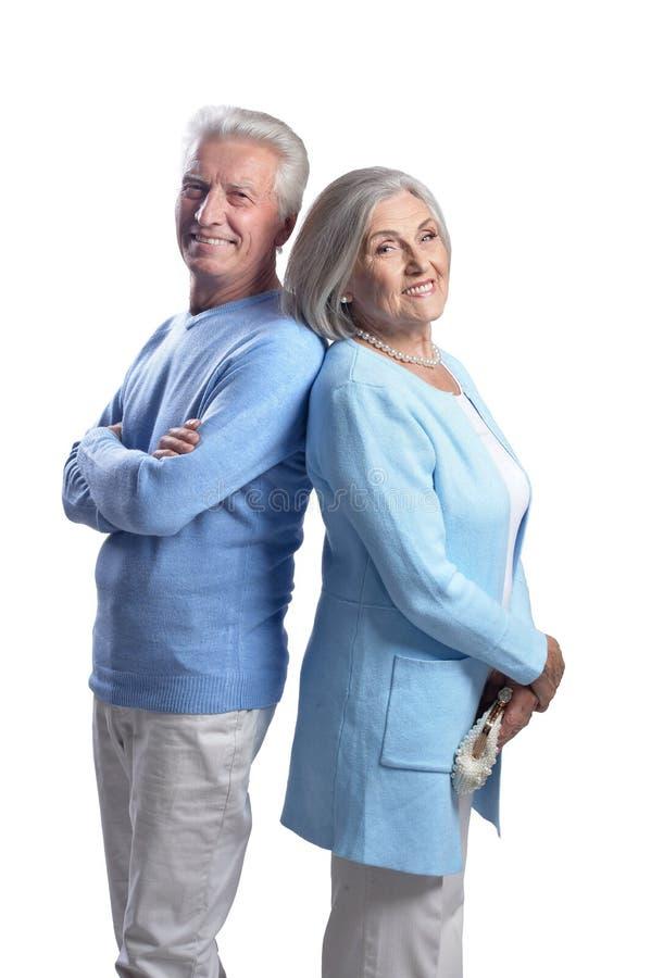 Happy beautiful senior couple posing on white background royalty free stock images