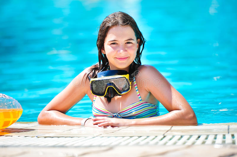 Download Happy Beautiful Teen Girl Smiling At The Pool Stock Image - Image: 26197737