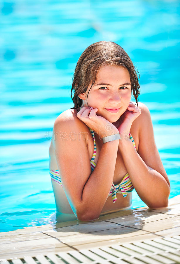 Happy Beautiful Teen Girl Smiling At The Pool Royalty Free Stock Photo