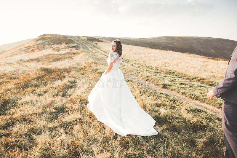 Happy beautiful wedding couple bride and groom at wedding day outdoors on the mountains rock. Happy marriage couple. Outdoors on nature, soft sunny lights royalty free stock photos