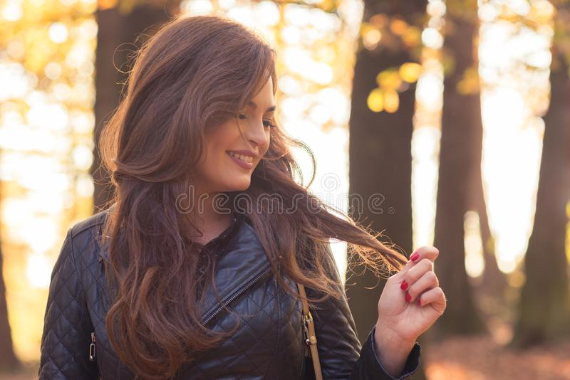 Happy beautiful woman in autumn park royalty free stock photo
