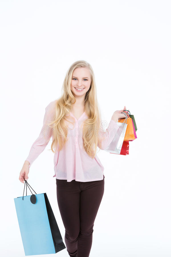 Happy beautiful woman with colorful shopping bags in her hands royalty free stock image