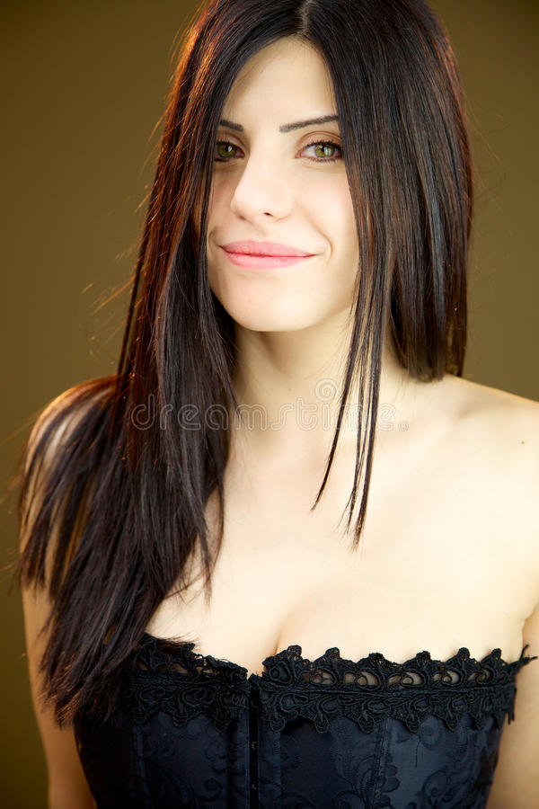Happy beautiful woman with corset smiling in studio royalty free stock photos