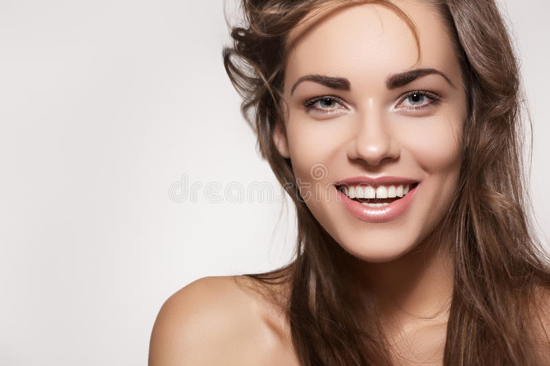 Happy beautiful woman. Cute smile with white teeth royalty free stock photography