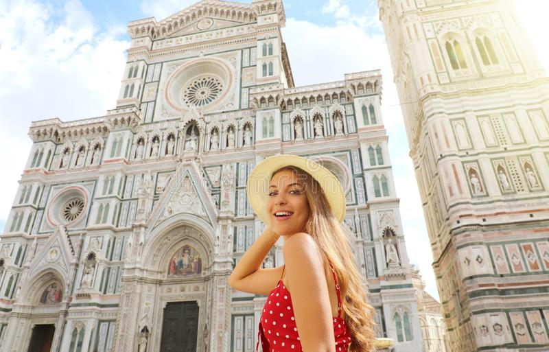 Happy beautiful woman enjoying her vacations in Tuscany. Smiling traveler girl enjoying her summer holidays in Florence, Italy royalty free stock photography