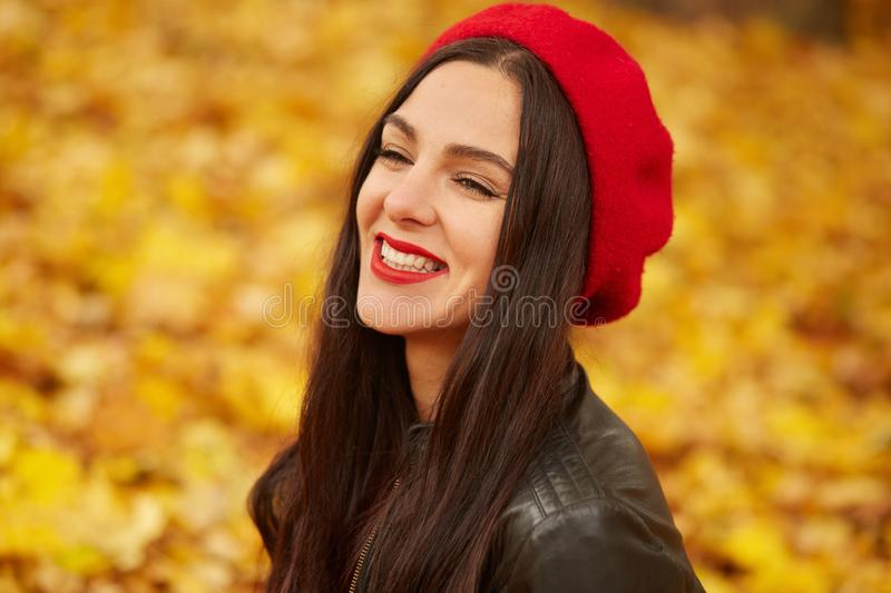 Happy beautiful woman, fashion model having fun in fall park, looking smiling away. Outdoors young pretty woman in autumn park, stock photos