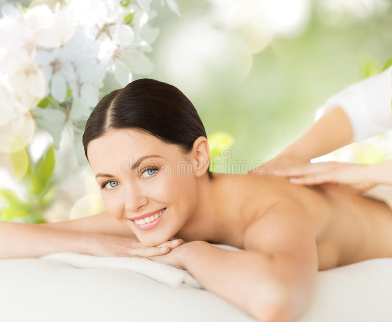 Happy beautiful woman having back massage stock image